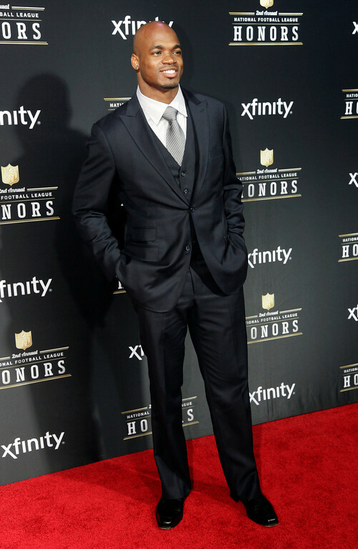 Description of . Adrian Peterson of the Minnesota Vikings arrives at the 2nd Annual NFL Honors on Saturday, Feb. 2, 2013 in New Orleans. (Photo by AJ Mast/Invision/AP)