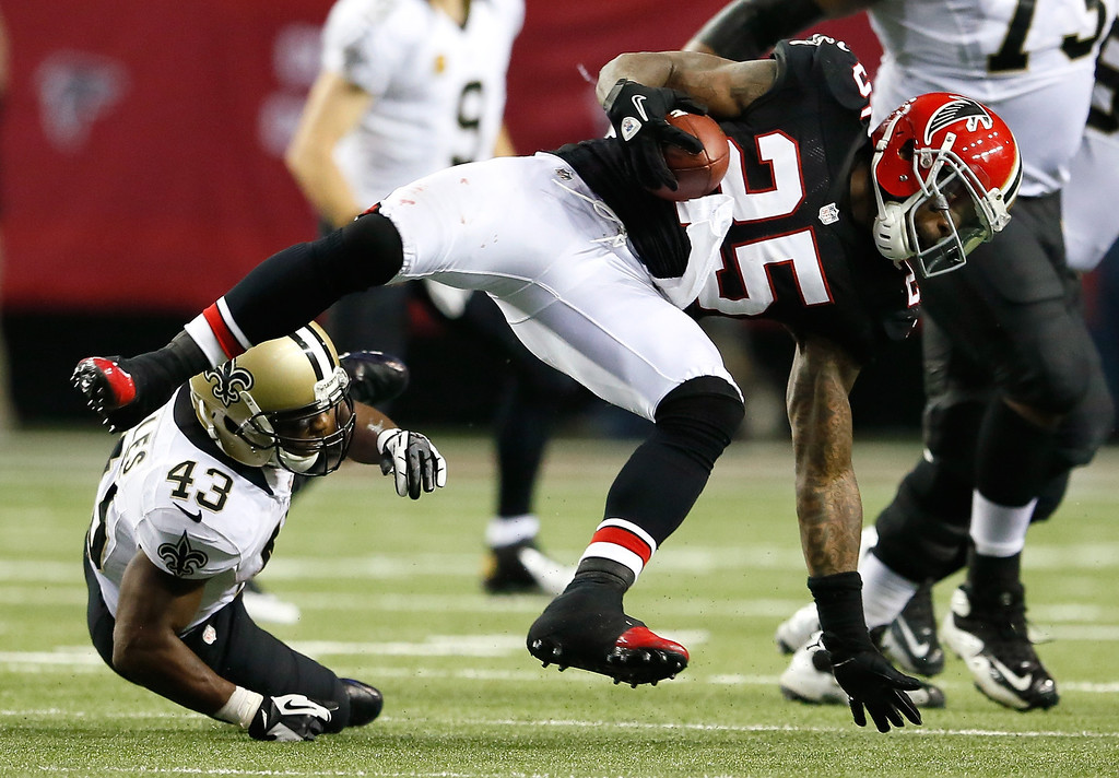 Description of . ATLANTA, GA - NOVEMBER 29:  William Moore #25 of the Atlanta Falcons returns an interception against the New Orleans Saints at Georgia Dome on November 29, 2012 in Atlanta, Georgia.  (Photo by Kevin C. Cox/Getty Images)