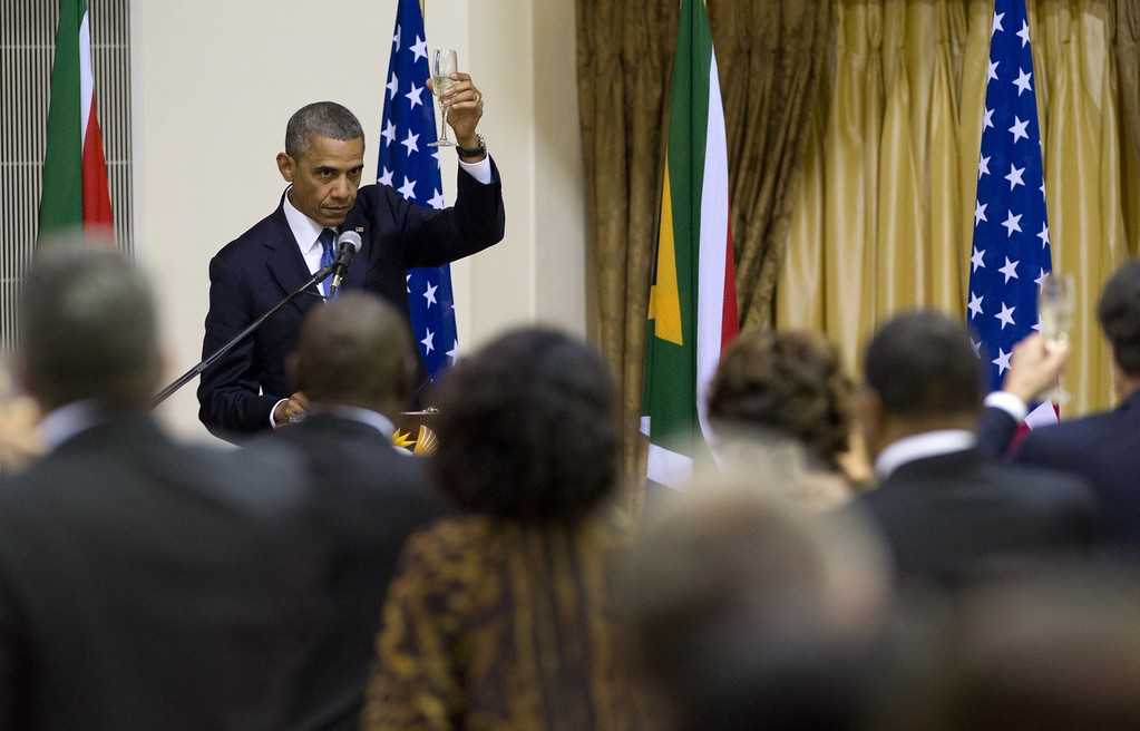 Description of . US President Barack Obama raises his glass for a toast during an official dinner hosted by the president of South Africa at the Presidential Guest House in Pretoria, South Africa, on June 29, 2013. SAUL LOEB/AFP/Getty Images