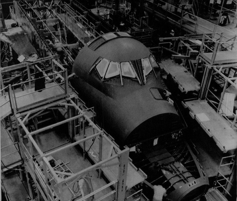 Description of . The space shuttle Challenger is shown under construction at the Palmdale Final Assembly Facility in Palmdale, Ca., in 1981. The crew module, shown in place in the chassis of the shuttle, was reported found on the floor of the Atlantic Ocean last week with the remains of at least some of the seven astronauts killed in the January explosion during launch still inside.  Denver Post Library Archive