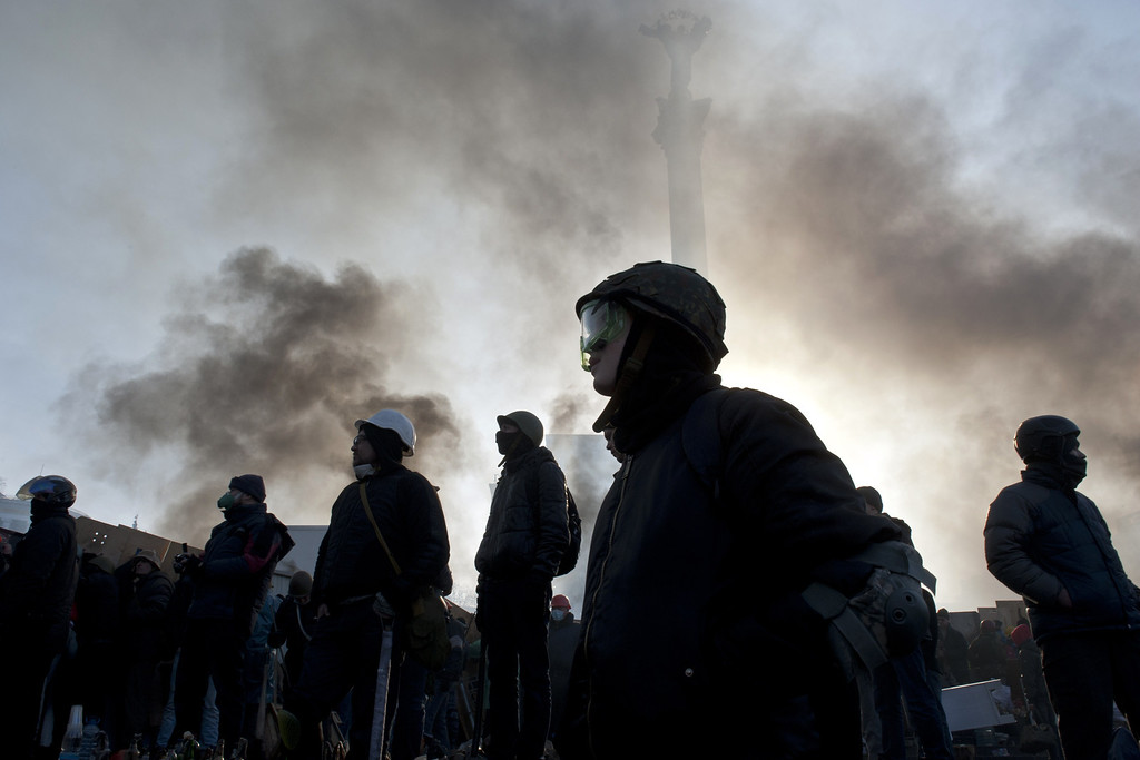 Description of . Anti-government protesters stand on Kiev's Independence square during clashes with riot police on February 19, 2014.   AFP PHOTO / PIERO QUARANTA/AFP/Getty Images