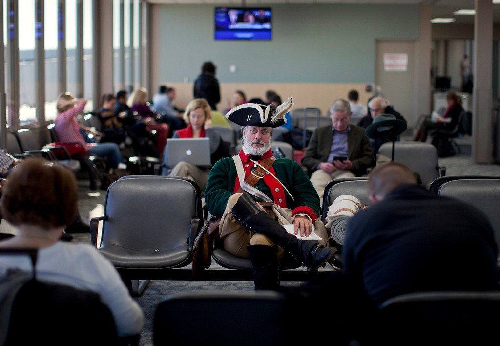 Description of . In this Jan. 4, 2012 file photo, tea party supporter William Temple, of Brunswick, Ga., sits in the Des Moines Airport heading to go home after the Iowa caucus in Des Moines, Iowa.  (AP Photo/Evan Vucci, File)