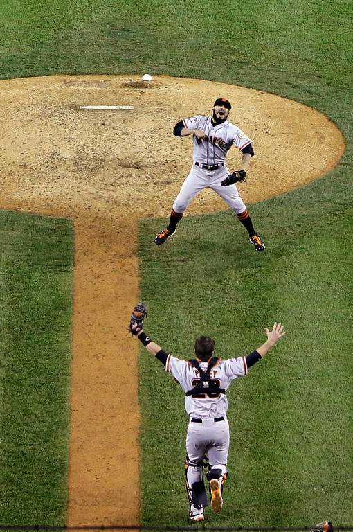 Description of . In this Oct. 28, 2012 file photo, San Francisco Giants relief pitcher Sergio Romo (54) and catcher Buster Posey and celebrate after striking out Detroit Tigers third baseman Miguel Cabrera (24) to win Game 4 of baseball's World Series in Detroit. The Giants won 4-3. (AP Photo/Tim Donnelly, File)