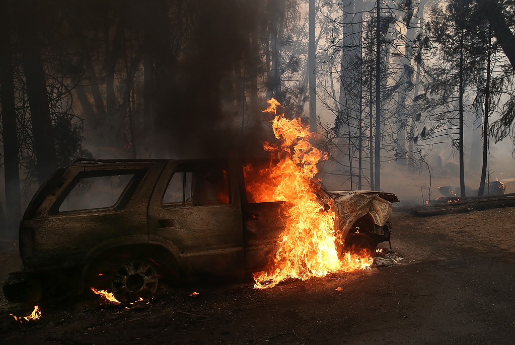 Description of . Flames billow from the front of a car that was consumed by the Rim Fire on August 25, 2013 near Groveland, California.  (Photo by Justin Sullivan/Getty Images)
