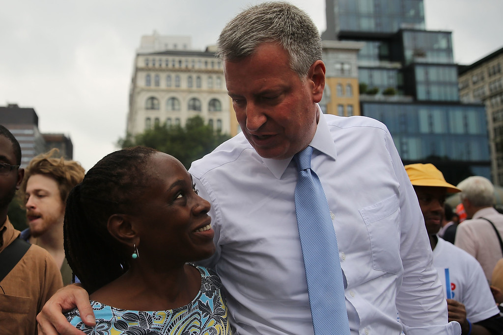 Description of . Public Advocate and mayoral candidate Bill de Blasio walks with his wife Chirlane McCray after making an appearance in Union Square in support of demonstrating fast food workers on August 29, 2013 in New York City.  (Photo by Spencer Platt/Getty Images)
