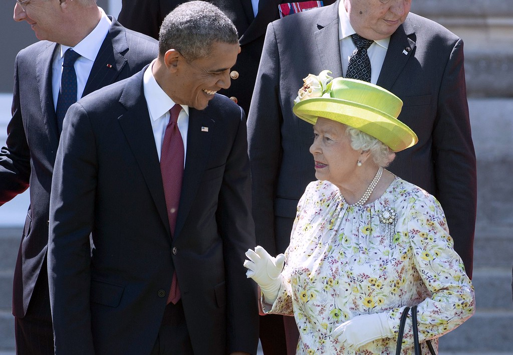 Description of . Queen Elizabeth II speaks with US President Barack Obama during a group photo of world leaders attending the D-Day 70th Anniversary ceremonies at Chateau de Benouville in Benouville, France, June 6, 2014.  AFP PHOTO / Saul LOEB/AFP/Getty Images