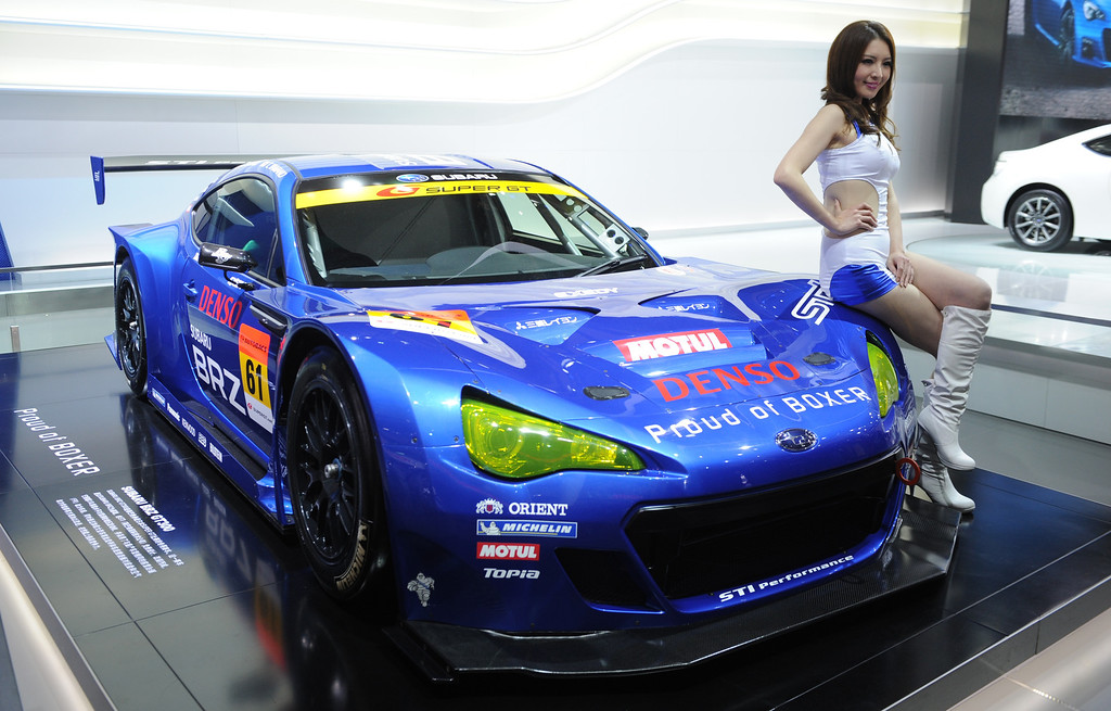 Description of . This photo taken on April 20, 2013 shows a model posing next to a Subaru BRZ racing car on media day at the Shanghai auto show. The Shanghai auto show, which opens to the public on April 21, is expected to attract more than 800,000 visitors over the course of nine days.   PETER PARKS/AFP/Getty Images