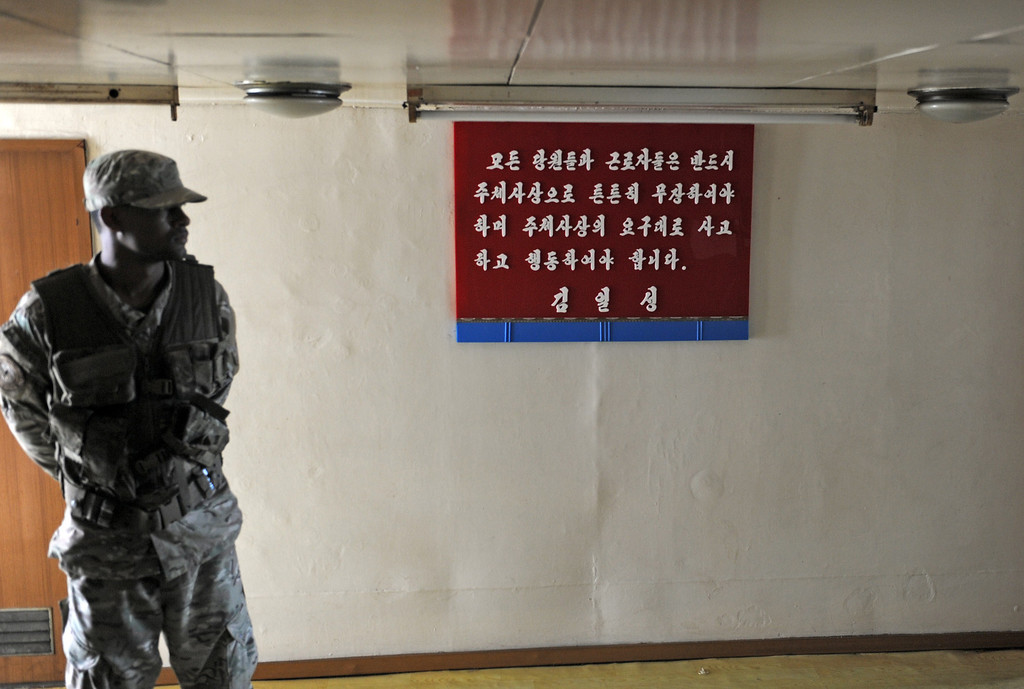 Description of . A member of the air and sea police officer stands guard inside North Korean vessel Chong Chong Gang at Manzanillo harbor in Colon, 90km from Panama City on July 16, 2013. AFP PHOTO / Rodrigo ARANGUA/AFP/Getty Images
