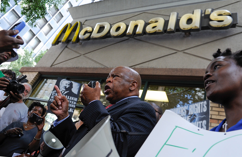 Description of . U.S. Representative John Lewis, D-Ga., speaks to demonstrators gathered at Five Points plaza protesting for higher wages for  workers in the fast food industry during a one day strike coinciding with other strikes  across the country, Thursday, Aug. 29, 2013, in Atlanta. (AP Photo/John Amis)