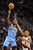 Denver Nuggets point guard Ty Lawson (3) hits a jump shot over Portland Trail Blazers point guard Damian Lillard (0) during the fourth quarter of their NBA basketball game in Portland, Oregon, February 27, 2013. The Denver Nuggets won the game 111-109. REUTERS/Steve Dykes