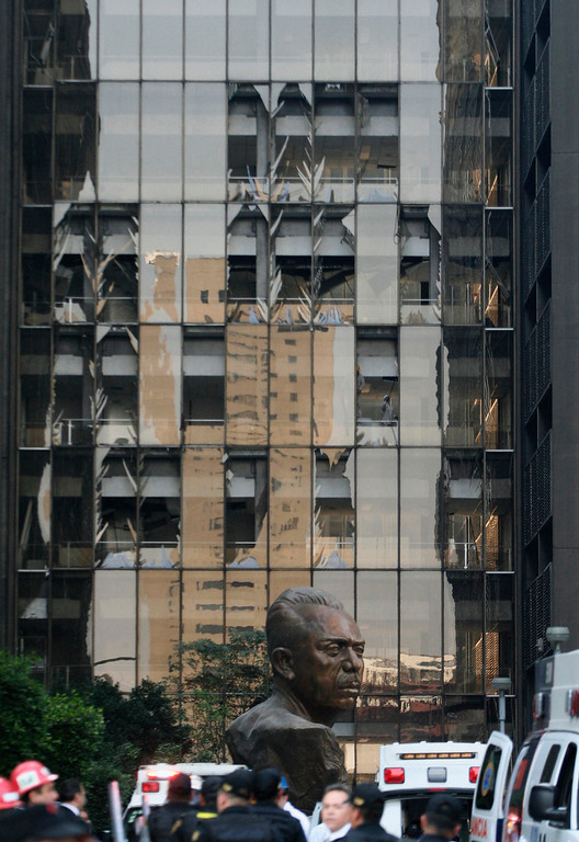 Description of . Shattered windows are seen on one side of the headquarters of state oil giant Pemex in Mexico City January 31, 2013. A powerful explosion rocked the Mexico City headquarters of state oil giant Pemex on Thursday, killing at least 14 people and injuring 100 others. The blast hit the lower floors of the downtown tower block, throwing debris into the streets and sending workers running outside.  It was not yet clear what caused the explosion, and the death toll could still rise, he added.   REUTERS/Alejandro Dias