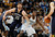Memphis Grizzlies center Marc Gasol, left, looks for a pass while working for position with Denver Nuggets forward Kenneth Faried during the third quarter of the Nuggets' 87-80 victory in an NBA basketball game in Denver on Friday, March 15, 2013. (AP Photo/David Zalubowski)