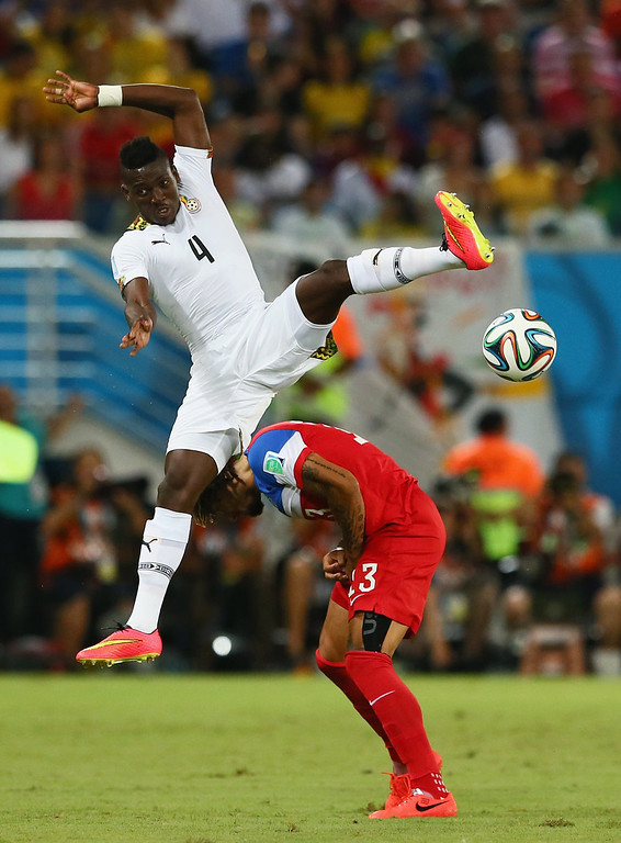 Description of . Daniel Opare of Ghana competes for the ball with Jermaine Jones of the United States during the 2014 FIFA World Cup Brazil Group G match between Ghana and the United States at Estadio das Dunas on June 16, 2014 in Natal, Brazil.  (Photo by Kevin C. Cox/Getty Images)