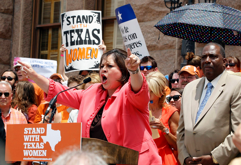 Description of . Leticia Van de Putte, a democrat from San Antonio, speaks at a protest before the start of a special session of the Legislature in Austin, Texas on July 1, 2013. When the Texas Legislature convenes on Monday for a second special session, the Republican majority will seek to do what it couldn't pull off in the first, when Democrat Wendy Davis stalled the measure on abortion restrictions for hours.  REUTERS/Mike Stone