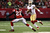 Quarterback Colin Kaepernick #7 of the San Francisco 49ers runs the ball against cornerback Asante Samuel #22 of the Atlanta Falcons in the second quarter in the NFC Championship game at the Georgia Dome on January 20, 2013 in Atlanta, Georgia.  (Photo by Streeter Lecka/Getty Images)