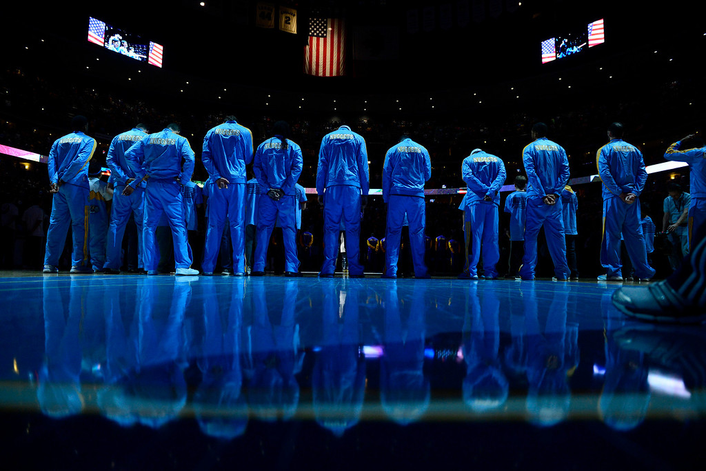 Description of . The Denver Nuggets stand for the National Anthem during the first half at the Pepsi Center on Wednesday, December 26, 2012. AAron Ontiveroz, The Denver Post