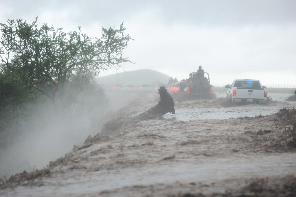 Description of . Residents of El Zapotillo are evacuated by the army because of the over flooding of the neighboring river, in the state of Sinaloa, Mexico, on September 19, 2013. Deaths from floods and landslides battering Mexico neared 100 on Thursday as a fresh hurricane hit the northwest and rescuers faced a risky mission in a village buried in mud.  AFP PHOTO/FERNANDO  Brito/AFP/Getty Images