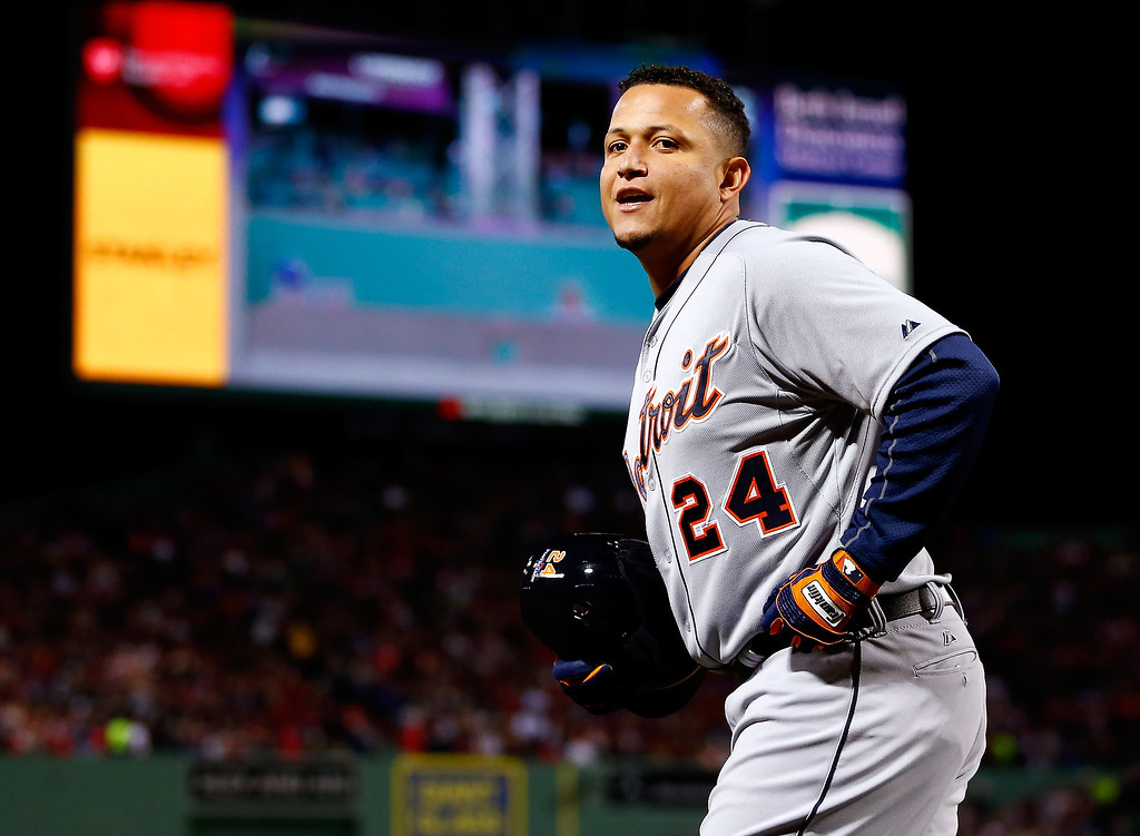 Description of . Miguel Cabrera #24 of the Detroit Tigers celebrates after hitting a home run in the sixth inning against the Boston Red Sox during Game Two of the American League Championship Series at Fenway Park on October 13, 2013 in Boston, Massachusetts.  (Photo by Jared Wickerham/Getty Images)