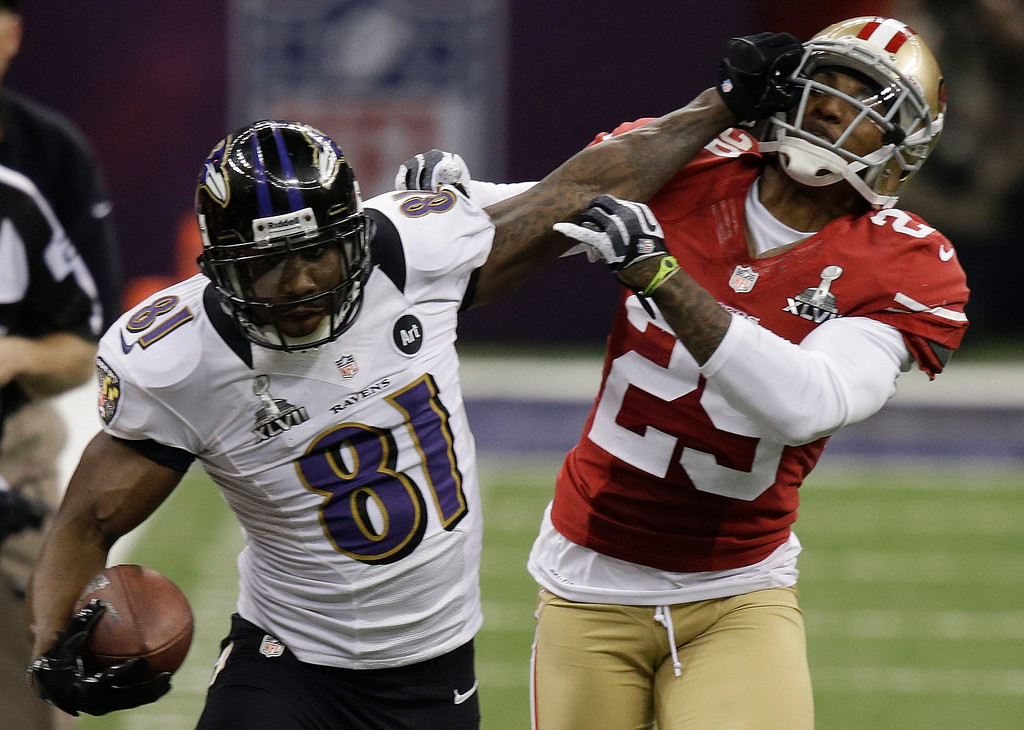 Description of . Baltimore Ravens wide receiver Anquan Boldin (81) stiff-arms San Francisco 49ers cornerback Chris Culliver (29) during the second half of the NFL Super Bowl XLVII football game, Sunday, Feb. 3, 2013, in New Orleans. (AP Photo/Gene Puskar)