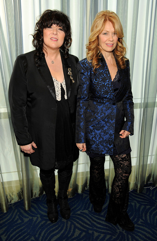 Description of . Rock and Roll Hall of Fame inductees Ann Wilson, left, and her sister Nancy Wilson of the band Heart pose together following a news conference to announce the 2013 inductees, Tuesday, Dec. 11, 2012, in Los Angeles. The ceremony will be held at the Nokia Theatre L.A. Live in Los Angeles on April 18, 2013. (Photo by Chris Pizzello/Invision/AP)