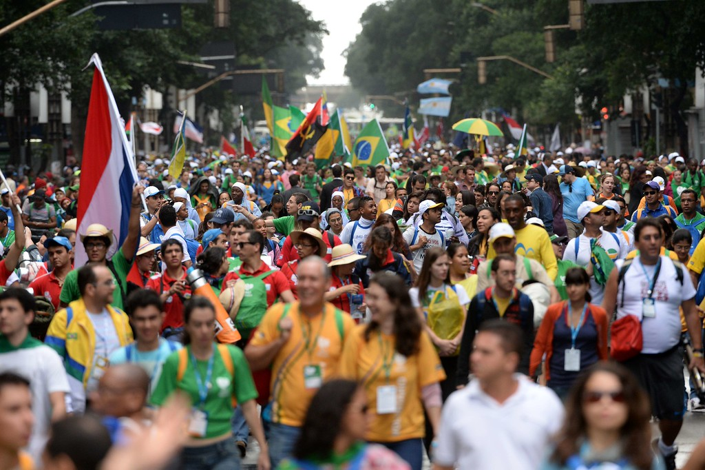 Description of . Pilgrims walk across Rio de Janeiro to reach Copacabana beach to join hundreds of thousands of other young Catholics attending World Youth Day (WYD) for a prayer vigil with Pope Francis on July 27, 2013. In a speech to Brazil's political, religious and civil society leaders earlier, Pope Francis said a