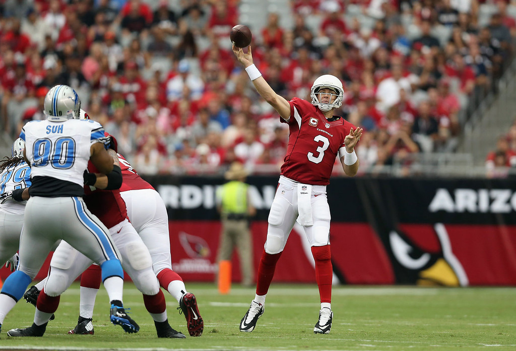 Description of . Quarterback Carson Palmer #3 of the Arizona Cardinals drops back to pass against the Detroit Lions in the first quarter at University of Phoenix Stadium on September 15, 2013 in Glendale, Arizona.  (Photo by Jeff Gross/Getty Images)