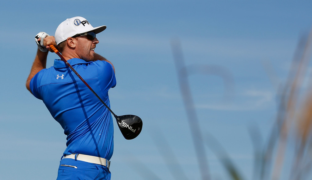 Description of . Hunter Mahan of the United States plays a shot of the 18th tee during the third round of the British Open Golf Championship at Muirfield, Scotland, Saturday July 20, 2013. (AP Photo/Matt Dunham)