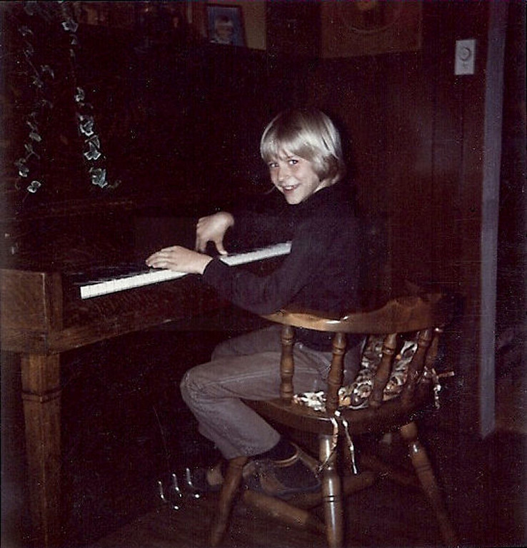 Description of . In this undated photo provided by Kim Cobain, a young Kurt Cobain plays piano in his childhood home in Aberdeen, Wash.   (AP Photo/Courtesy Kim Cobain)