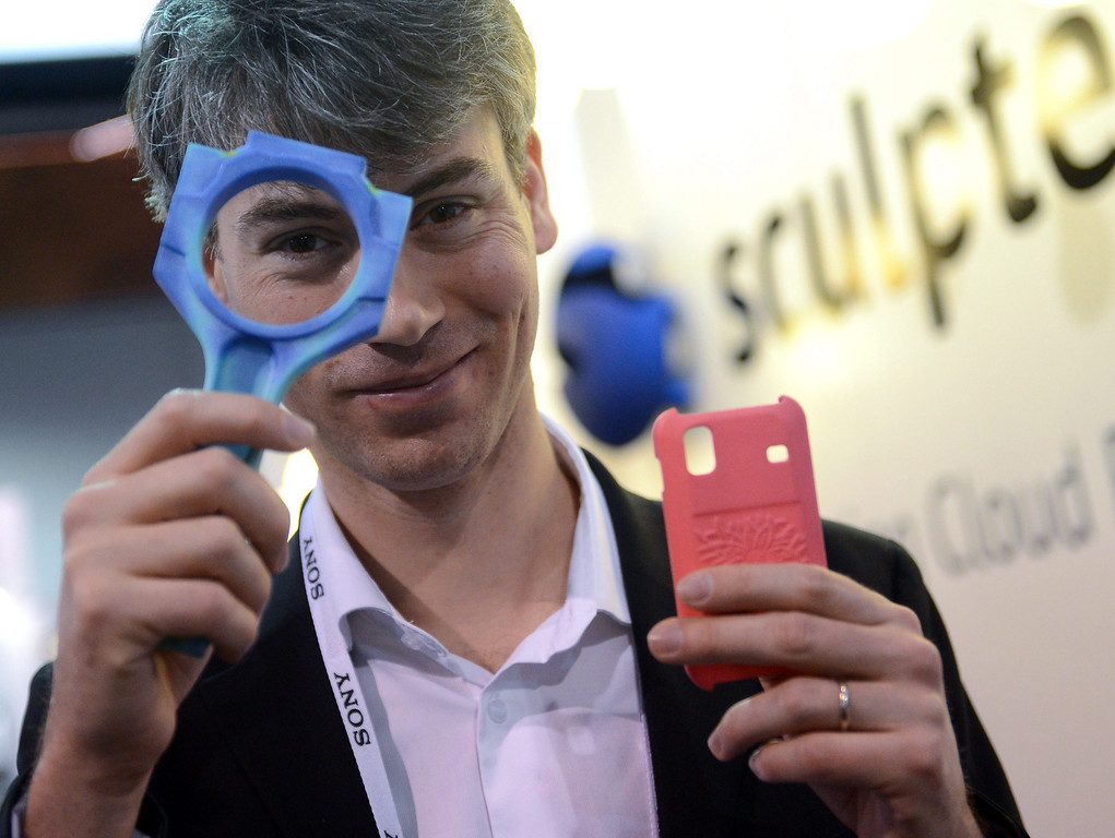 Description of . Founder of the company Sculpteo, Clement Moreau, displays items printed with a 3D printer at the Consumer Electronics Show (CES) 2014 in Las Vegas, USA, 08 January 2014. The fair runs from 07 to 10 January 2014. This new way of printing objects can create anything from guns to doorknobs to replacement parts for a dishwasher. The technology is getting closer to mass market appeal as it becomes cheaper. Reports state online retailers are eying a world where people shop on the internet and then print out their purchases at home.  EPA/BRITTA PEDERSEN