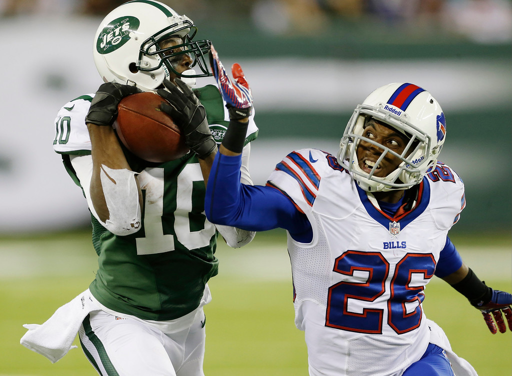 Description of . New York Jets\' Santonio Holmes (10) catches a pass for a touchdown as Buffalo Bills defensive back Justin Rogers (26) defends during the second half of an NFL football game Sunday, Sept. 22, 2013, in East Rutherford, N.J. (AP Photo/Seth Wenig)