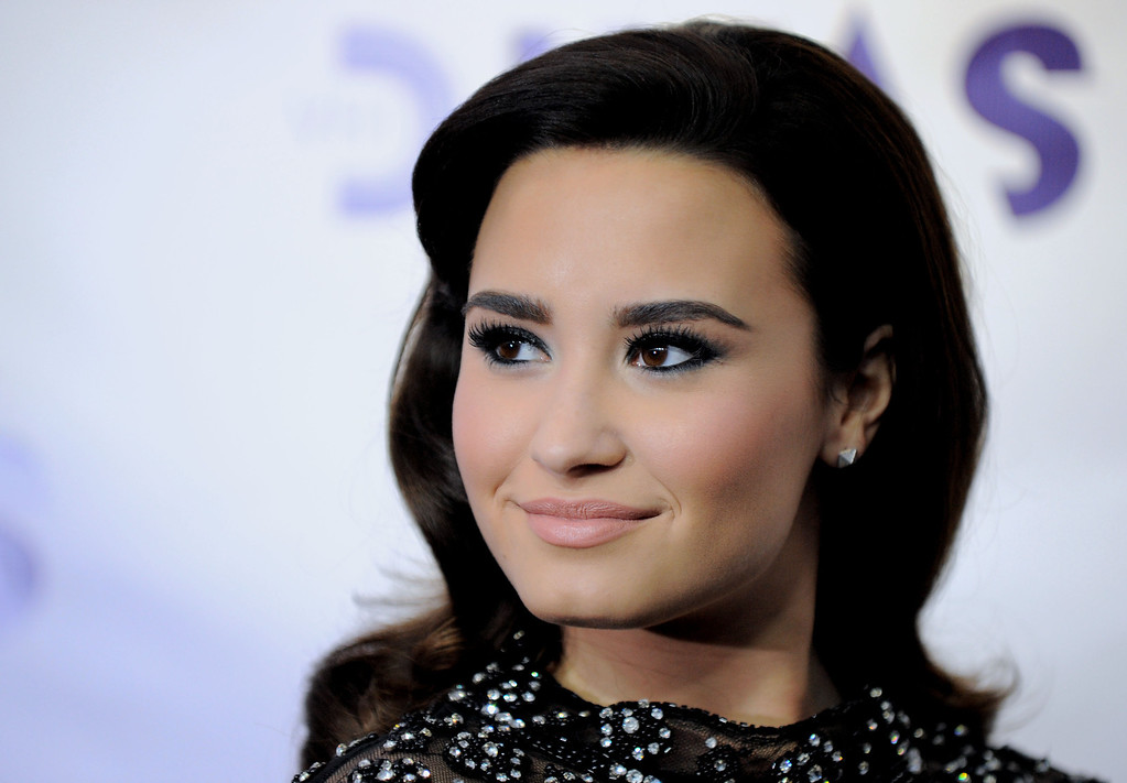 Description of . Demi Lovato arrives at VH1 Divas on Sunday, Dec. 16, 2012, at the Shrine Auditorium in Los Angeles. (Photo by Jordan Strauss/Invision/AP)