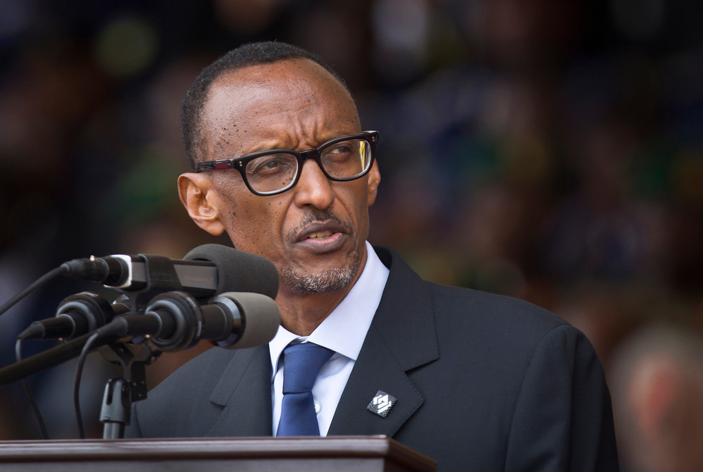 Description of . Rwandan President Paul Kagame addresses the public and dignitaries at a ceremony to mark the 20th anniversary of the Rwandan genocide, at Amahoro stadium in Kigali, Rwanda Monday, April 7, 2014.  (AP Photo/Ben Curtis)