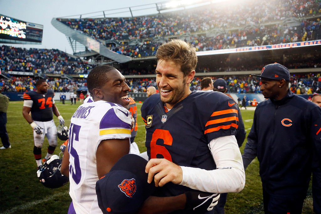 Description of . Minnesota Vikings wide receiver Greg Jennings (15) and Chicago Bears quarterback Jay Cutler (6) laugh after their NFL football game on Sunday, Sept. 15, 2013, in Chicago. The Bears won 31-30. (AP Photo/Charles Rex Arbogast)