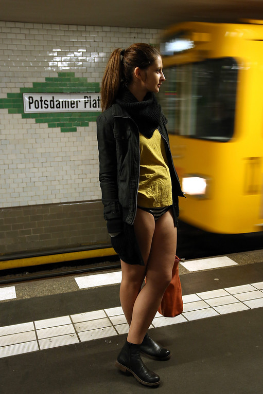 Description of . A participant of the No Pants Subway Ride prepares to board an approaching train on January 12, 2014 in Berlin, Germany. The annual event, in which participants board a subway car in January while not wearing any pants while behaving as though they do not know each other, began as a joke by the public prank group Improv Everywhere in New York City and has since spread around the world, with enthusiasts in around 60 cities and 29 countries across the globe, according to the organization's site.  (Photo by Adam Berry/Getty Images)