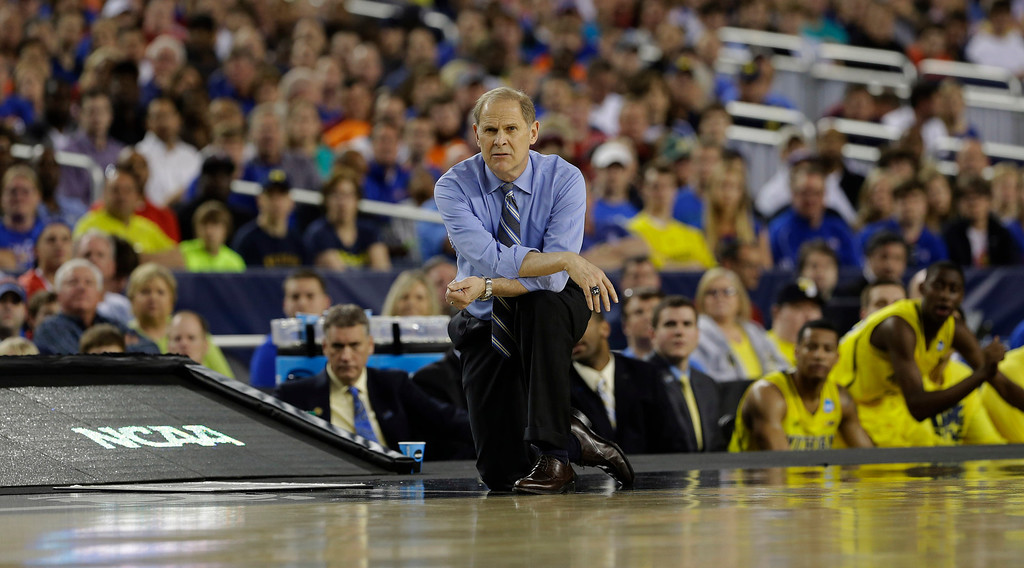 Description of . Michigan head coach John Beilein watches during the first half of a regional semifinal game against Kansas in the NCAA college basketball tournament, Friday, March 29, 2013, in Arlington, Texas. (AP Photo/Tony Gutierrez)
