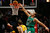 Chicago Bulls' Joakim Noah (R) dunks the ball over Denver Nuggets' Kosta Koufos during the first half of their NBA basketball game in Chicago, Illinois March 18, 2013.  REUTERS/Jim Young