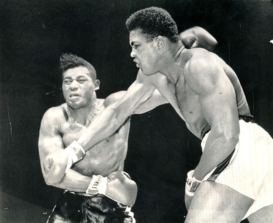 Description of . CLAY LANDS A SMASH--Champion Cassius Clay lands a right smash to the jaw of challenger Floyd Patterson in the seventh round of their title fight at Las Vegas, Nev.  (AP Wirephoto) 1965 Heavyweight champion Cassius Clay lands a hard right tot he face of challenger Floyd Patterson in the seventh round of title fight in Las Vegas on Nov. 22.  Clay gave Patterson a severe beating before fight was stopped in the 12th. Clay was still at it in the seventh round, pouring a barrage of blows to Patterson's head.  This one makes the challenger's eyes roll and it's obvious he's in more than a little pain. Credit: AP