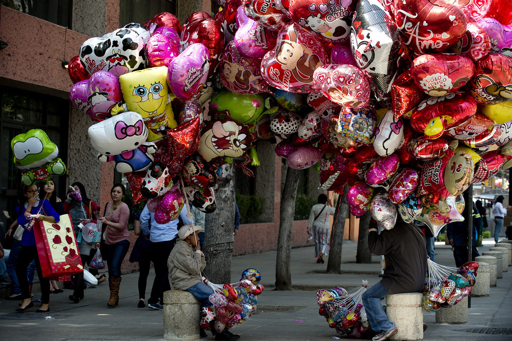 Description of . Street vendors sell Valentine's Day gifts during Mexico's