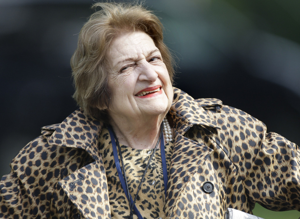 Description of . In this Oct. 16, 2007 file photo, veteran White House correspondent Helen Thomas smiles as she leaves the White House after attending a briefing. Thomas, the White House correspondent who used her seat in the front row of history to grill nine presidents, died July 20, 2013. She was 92. (AP Photo/Ron Edmonds, File)