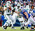New York Jets quarterback Mark Sanchez (6) is pressured by Buffalo Bills defensive tackle Kyle Williams (95) during the first half of an NFL football game on Sunday, Dec. 30, 2012, in Orchard Park, N.Y. (AP Photo/Bill Wippert)