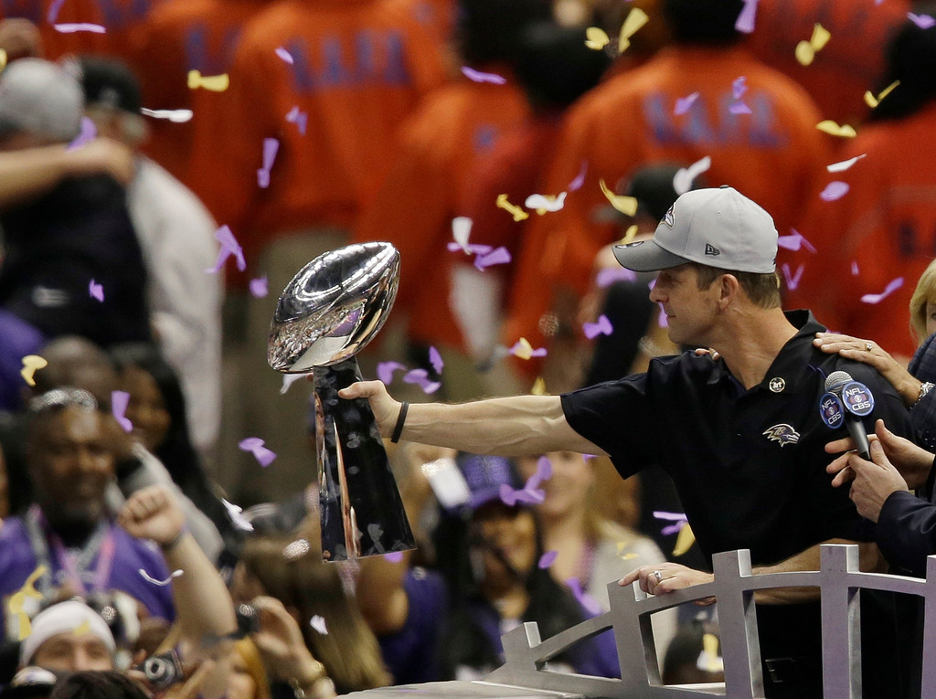 Description of . Baltimore Ravens head coach John Harbaugh holds the Vince Lombardi Trophy as he celebrates after the NFL Super Bowl XLVII football game against the San Francisco 49ers, Sunday, Feb. 3, 2013, in New Orleans. The Ravens won 34-31. (AP Photo/Gerald Herbert)