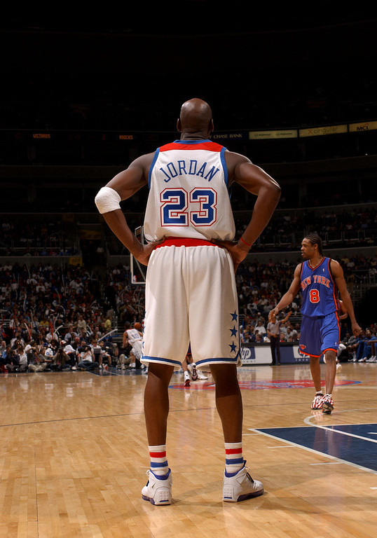 Description of . WASHINGTON - APRIL 14:  Michael Jordan #23 of the Washington Wizards awaits play downcourt as the New York Knicks defeated the Wizards 93-79 as Jordan played his final home game on April 14, 2003 at the MCI Center in Washington, D.C.  (Photo by Doug Pensinger/Getty Images)