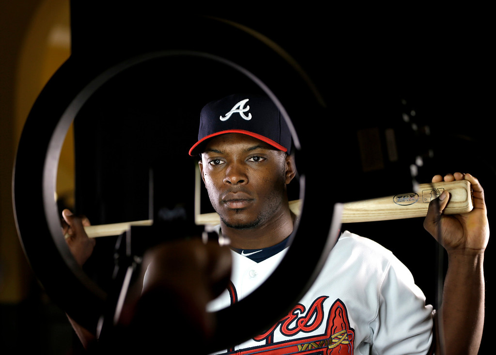 Description of . Atlanta Braves outfielder Justin Upton poses for a photographer during a spring training baseball picture day Wednesday, Feb. 20, 2013, in Kissimmee, Fla. (AP Photo/David J. Phillip)