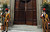 "This handout picture released by the Vatican Press Office on March 12, 2013 shows the doors of the Sistine chapel being closed at the start of a papal election election.  ""AFP PHOTO/OSSERVATORE ROMANO"