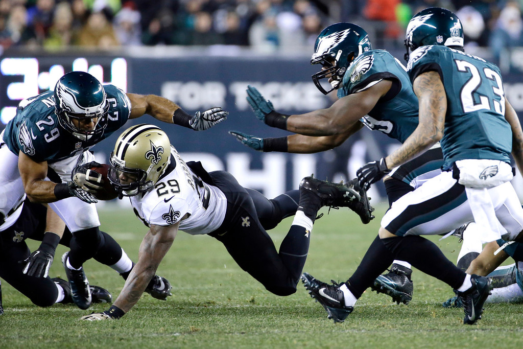 . New Orleans Saints\' Khiry Robinson (29) dives for extra yardage against Philadelphia Eagles\' Nate Allen (29), DeMeco Ryans, second from right, and Patrick Chung (23) during the first half of an NFL wild-card playoff football game, Saturday, Jan. 4, 2014, in Philadelphia. (AP Photo/Matt Rourke)