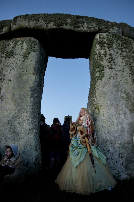 Description of . Revellers celebrate the pagan festival of \'Winter Solstice\' at Stonehenge in Wiltshire in southern England on December 21, 2012. BEN STANSALL/AFP/Getty Images