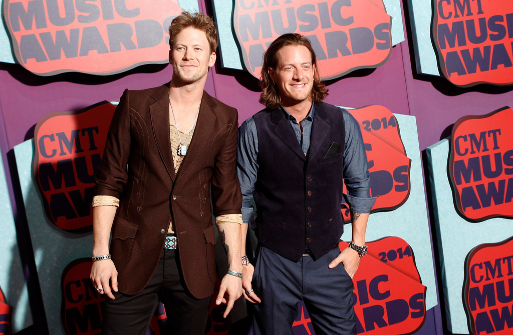 Description of . Brian Kelley, left, and Tyler Hubbard of the musical group Florida Georgia Line arrive at the CMT Music Awards at Bridgestone Arena on Wednesday, June 4, 2014, in Nashville, Tenn. (Photo by Wade Payne/Invision/AP)