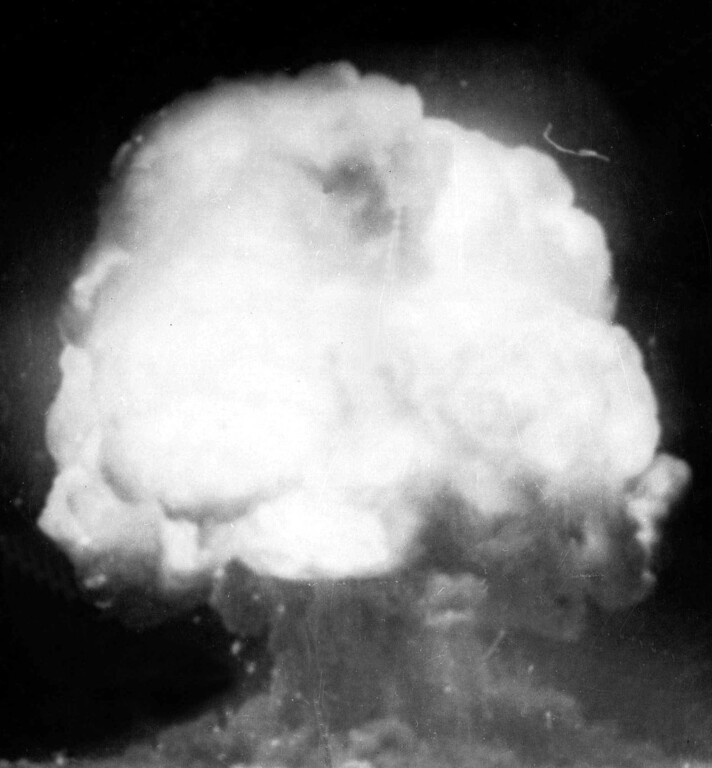 Description of . The first U.S. atom bomb explodes during a test in Alamogordo, N.M., July 16, 1945.  The cloud went 40,000 feet in the air, as viewed by an automatic camera six miles away from the site.  (AP Photo)