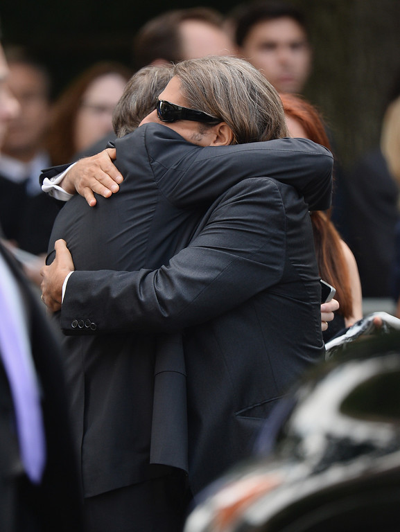 Description of . Actors Steve Buscemi (L) and Michael Imperioli embrace at the funeral for actor James Gandolfini at The Cathedral Church of St. John the Divine on June 27, 2013 in New York City.   (Photo by Mike Coppola/Getty Images)