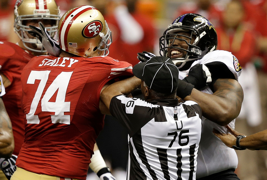 Description of . San Francisco 49ers offensive tackle Joe Staley (74) is separated from Baltimore Ravens defensive end Arthur Jones (97) by umpire Darrell Jenkins during the first half of the NFL Super Bowl XLVII football game, Sunday, Feb. 3, 2013, in New Orleans. (AP Photo/Elise Amendola)